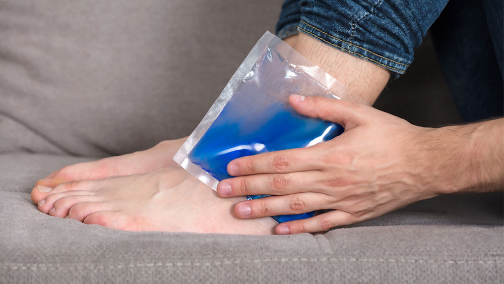 how to treat a sprained ankle at home